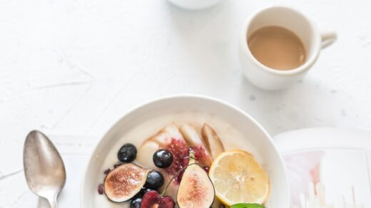 a plate full of healthy fruits and tea